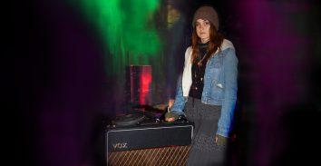 artist,, Theresa Wayman, standing next to VOX amplifier